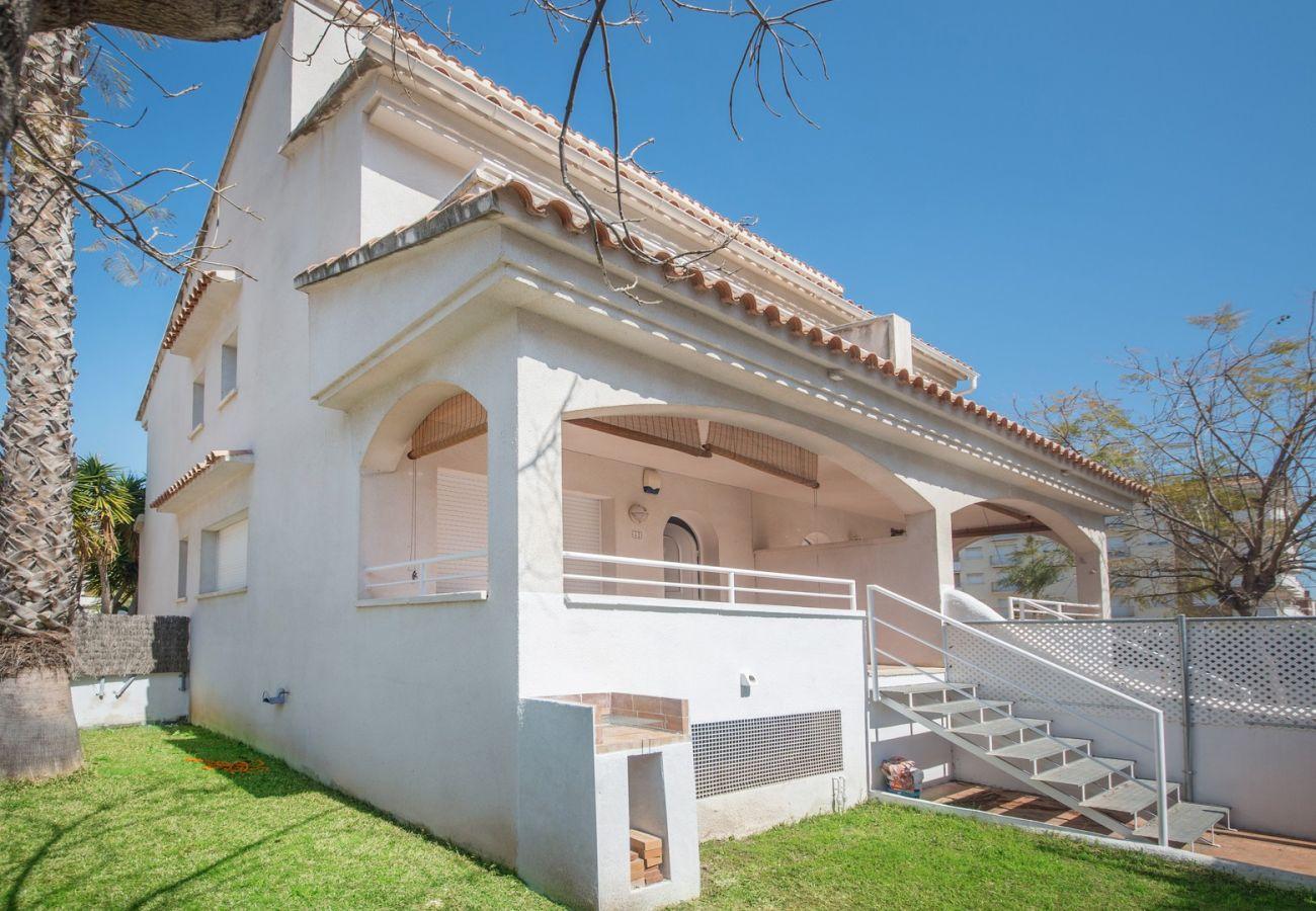 Casa adosada en Calafell - R22-1 Casa adosada con AC y jardin 100m de la playa