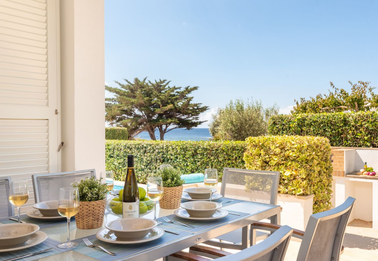 the terrace of this villa in Binisafuller, ideal for moments of tranquillity during your trip.